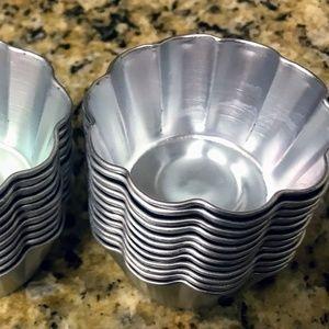 Scalloped-edged individual metal cupcake tins
